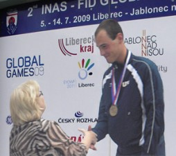 Cyclist Syd Lea accepting one of his 5 Global Games medals.